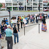 People gather on the steps of Lynn City Hall for the Rally and March Against Racism on Saturday.