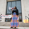 "Cherish Casey of Lynn sings ""This Little Light of Mine"" during the Rally and March Against Racism in Lynn on Saturday."