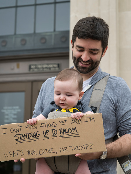 Thomas Smith-Vaughan and his 5-month-old son Thomas stand on the steps of Lynn City Hall and support the Rally and March Against Racism on Saturday.