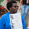 Rosa Bentley of Lynn holds up a black lives matter sign during the Rally and March Against Racism in Lynn.
