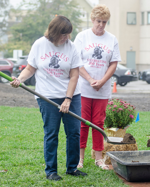 09/16/2017. Round Hill Historical Site, Saugus. Bicentennial anniversary of the incorporation of Saugus and time capsule burial. Melita Davis, right, looks on as Jean Swanson gets a shovel full of dirt ready to heap on the time capsule.