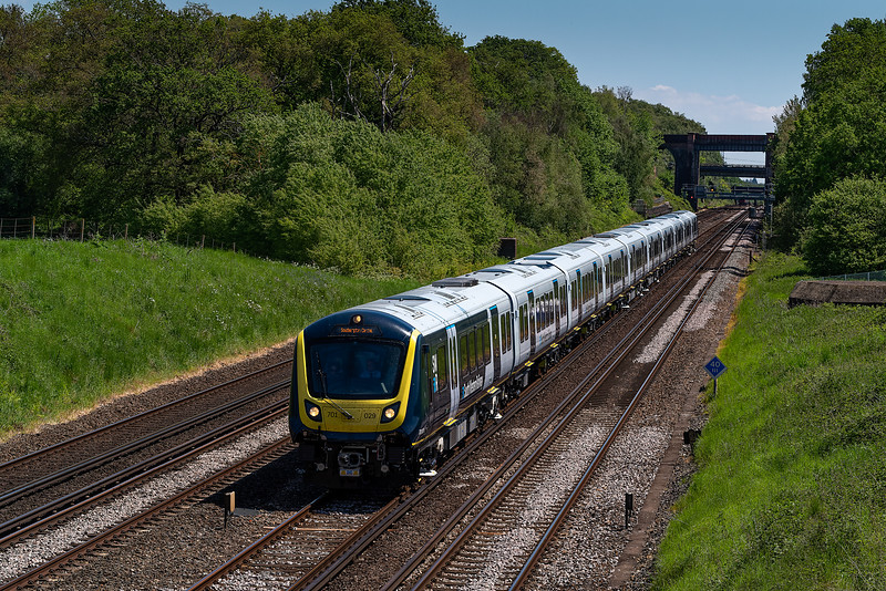 701029 at Totters Lane, Potbridge, with 5Q51, the 11:25 Staines Up Loop - Staines Up Loop, on 1st June 2021.
