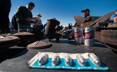 Pop top cans of Schlitz beer, spark plugs and table upon table of vintage car parts were on offer at the 45th Annual Early Ford V8 Club of N.E. Spring Tune Up at the Fitchburg Airport.