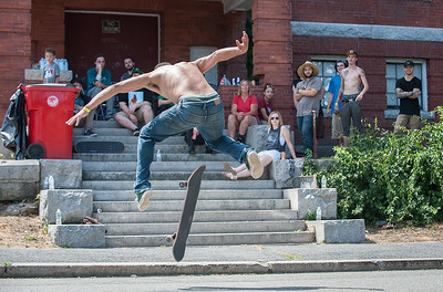 "Eric ""Skippy"" Scipione of Leominster competes in the Frankie Fortuna Skate Challenge held on Townsend St outside the Acid Reign skate shop. TFriends of Frankie Fortina sit and watch form the steps of the old East St School. SENTINEL&ENTERPRISE/ Jim Marabello"