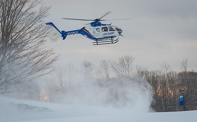 GARDNER - The UMass LifeFlight helicopter kicks up a swirl of snow as it approaches the landing zone at Mount Wachsett Community College. It arrived to pick up the victim of an assault on Templeton. Thursday January 18, 2018 [Photo/Jim Marabello]