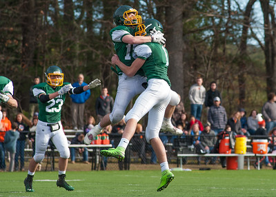 Oakmont place kicker Nick Ricci (far right) is congratulated by holder Nate McCartney after blasting a 46 yard field goal in the 3rd quarter Thanksgiving Day against Gardner.