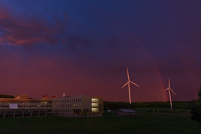 31 May, 2017. A vivid sky and double rainbow manifests itself behind the wind turbines and brand new Asquino Science Center at Mount Wachusett Community College In Gardner Massachusetts. A sharp line of storms  made it's way through New England.