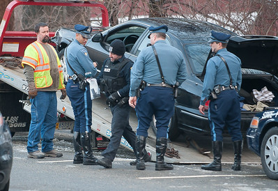 A Leominster Police officer recovers a handgun from the suspect vehicle in an armed robbery of the CVS on Mill St in Leominster. The vehicle was observed on Rt 2 and followed by State Police until it was stopped on Elm St in Gardner. The operator was arrested and passenger released.