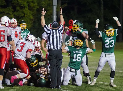 Oakmont players Andres Stefanakos #16 Grant Jensen #65 and CJ Kelleher #23 react as a linesman signals a touchdown by QB Shamus Gorman that made the score 28-24 against Tyngsborough.