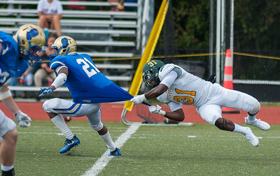 Fitchburg State's Melchior Lynch hangs on to the tail of  Worcester State RB Bemnet Morgan  Saturday September 16, 2017.