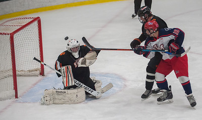 North Middlesex forward Matthew DeVito tries to bat one past Marlborough goalie Owen O'Brien in late 2nd period action.
