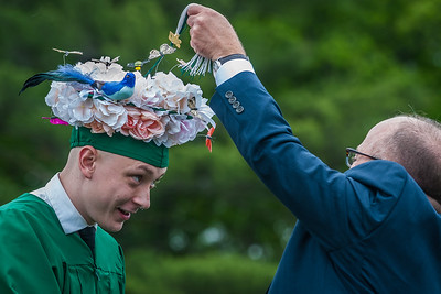 Jack Hollenbeck, Oakmont Class of 2017 gets his tassel flipped by District Superintendant Dr Gary Mazzola while sporting a floral arrangement motif on his mortarboard at the Oakmont Regional High School Class of 2017 Commencement. SENTINEL&ENTERPRISE/ Jim Marabello