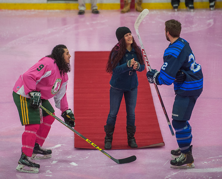"Breast Cancer survivor Gretchen Rojas (center) of Elkridge MD, and mother of FSU F Nate Rojas (left) talks to Westfield State Captain Kyllian Kirkwood after dropping the ceremonial first puck prior to the start of the ""Pink on the Rink"" game at the Gaetz Arena."