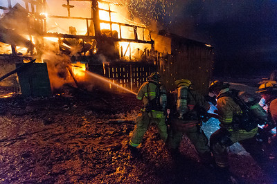 STERLING - Firefighters work to contain a fully involved barn fire on Chace Hill Rd. Saturday, March 10, 2018 [Photo-JIm Marabello]