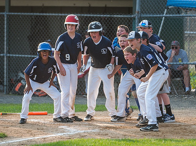 Leominster LL All-Stars wait at home to greet  Nick Garcia who belted a 3 run homer to put his team ahead 7-5 against Holden LL in a playoff game in Paxton. Holden rallied in the bottom of the 6th to beat Leominster 8-7.