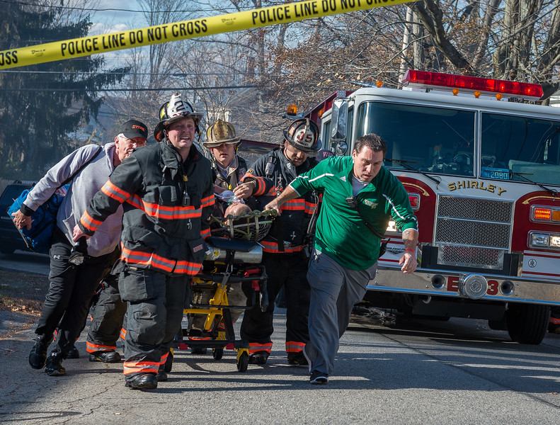AYER - Firefighters rush an  injured firefighter to a waiting ambulance during a 3rd Alm fire at 33 Washington St. Wednesday, November 15, 2017 [Photo/Jim Marabello]
