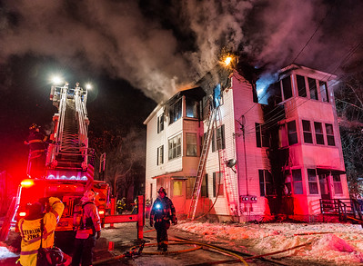 LEOMINSTER - Smoke billows from a 3 decker during a 2nd Alm fire on 5th St. Saturday, December 30, 2017 {Photo/Jim Marabello]