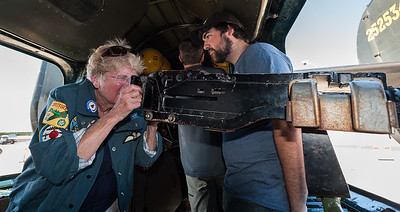 Maggie Dana of Old Saybrook, Ct, originally of London, England checks out a machine gun inside 'Withcraft,' the only flying B-24J WWII bomber at the Wings of Freedom Airshow at Worcester Airport.  She recalled seeing B-24s and other bombers flying over her house on their way to Germany near the end of WWII. At right is her grandson, Noah Dana of Goshen, Mass. Sunday September 24, 2017.