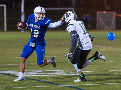 Leominster QB Noah Gray stiffarms Wachusett defender Jon Rubin late in the game at Doyle Field.