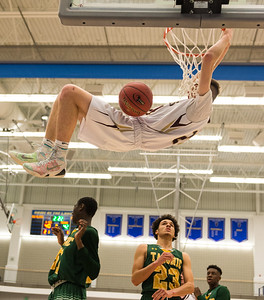 Shepherd HIll's Kenneth Flynn goes horizontal  after a dunk against Taconic in the Boy's Div II State Semi-Final At Worcester State. Wednesday March 14, 2018