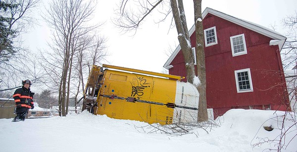 Gardner FF Andy Fields stands by an overturned rail car at a grade crossing on South Main St in Gardner. The car came witin inches of striking an occupied barn and house.