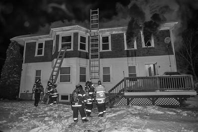 Fitchburg Firefighters throw ground ladders to the 2nd floor while other crews were inside searching for 2 persons reported trapped during the initial stages of a 2nd Alm fire at 176 Walton St. From left-right Lt Marty Kukkula, FF Kurvin Lopez, Lt Anthony Castelli, FF Patrick Haverty and Deputy Chief Dave Gravel.