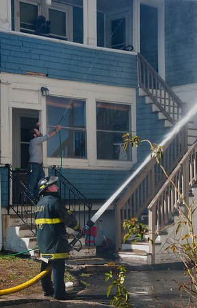 A Henry St neighbor's hose is no match for the one manned by a Fitchburg firefighter.
