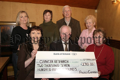 """Proceeds from the """"Big Breakfast"""" in Poyntzpass in aid of Cancer Research, Organised by Angela Campbell was presented to Gervase Mc Cartan (chairman of the newry branch ,cancer research),  Photo front l-r, Angela Campbell (organiser) presents a Cheque for £2710.00 to Gervase Mc Cartan (chairman) and Elizabeth Mitchelmore Hawkins (secretary), back l-r, Cora Trainor (committee), Marie Mc Donald(committee), Ivan Hamilton(treasurer) and Grace Mc Gaffin (committee). 05W16N51."""