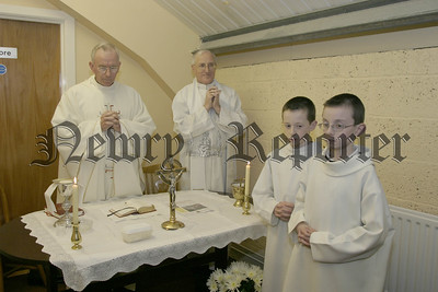 Fr Stanley and Fr Naughton of Middle Killeavey parish perform a special  mass at the official opening of the Sacred heart Conference premises, with Alter boys Colm & Fergal Murphy. 05W16N58.