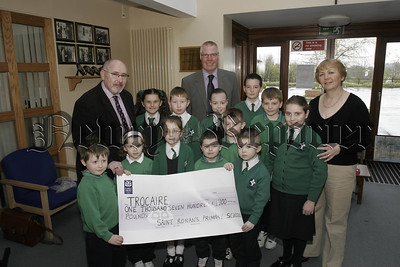 In picture pupils Primary 1 to 7, presented a cheque for £1700 to Trocaire, the money was raised from a Non Uniform Day anf Fundraising events at the school, also in picture,  Paul Kane, Regional Fundraiser Officer Trocaire, Mr Frank Dawson, Principle, Marian Keeley,(Teacher).05W16N1