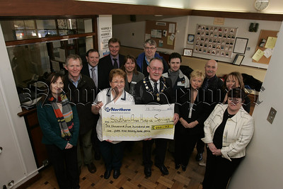 Represenatives from the Festival of Music, Myths , Legends and Vikings  present £6,501.73 to the Southern Area Hospice. 05W4N8