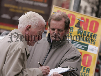 SDLP Cllr John McArdle collects a signature from Peter Cunningham who was one of hundreds who signed the petition voicing concerns over the proposed water charges. 05W4N6