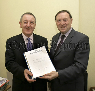 Former Chairman of Newry and Mourne District Council Jack Patterson, is presented with a pictorial record of his year in office by ÔNewry ReporterÕ Editor Austin Smyth. 05W8N20