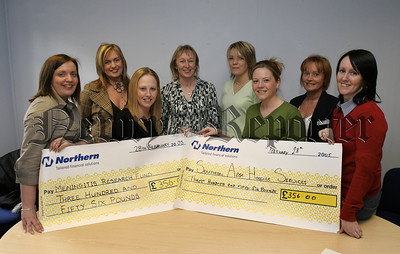 Customs And Excise,(VAT) Newry staff fundraisers have raised money for local charities, Christmas Draw, £356 each to Meningitis Research, and the Southern area Hospice. Pictured at the cheque presentation, Catriona Ruane, Clare Mc Guigan, Kerrie Mc Parland, Denise Hall, Paula Strain, (Meningitis Research), Lilian Patterson,Fiona Kieran, (SAH), Annmarie Fearon.