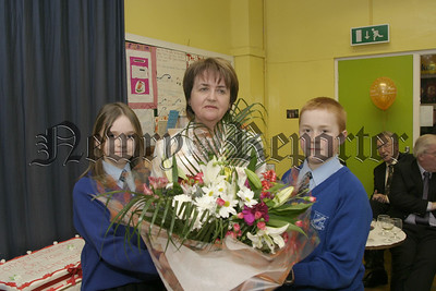 Retirement of Mrs Geraldine Kane as Vice Principle of Killean primary school. Presenting Mrs Kane with a bouquet of flowers are Aislinn Derby (head girl) and Niall King ( head boy). 05W9N56.