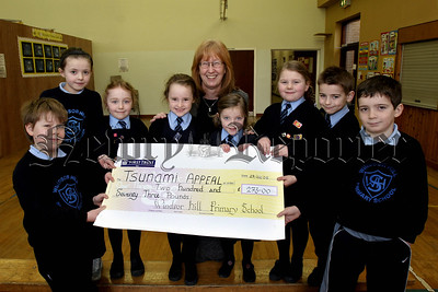 Windsor Hill PS help Tsunami Fund, through their usual generousity Windsor Hill pupils raised £273 in the month of January to help those who lost so much in the wake of the Tsunami. Pictured Principle Heather Ervine and pupils.