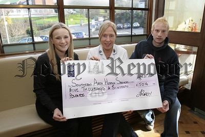 Cheque Presentation, Lto R. Sarah Evson, (Fundraiser SAH),Collette Flemming, (Staff Nurse SAH), Jeremy Purdy, Warrenpoint and a member of the Mourne Rescue Team presenting cheque for £5016, sponsored trek to Mt. Everest base camp in aid of the Southern Area Hospice.
