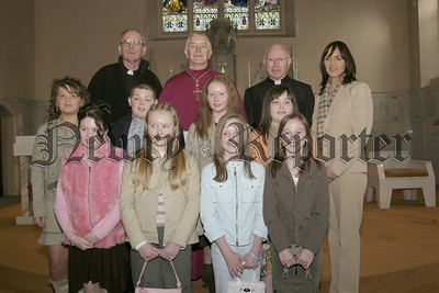 The seven girls and one boy from St Oliver's School Carrickrovaddy, who were confirmed in St Patrick's Cullyhanna by Bishop G Clifford (centre),also included in photo are  Rev Fr Cullen (left), Fr P Mc Guckin and School principle Miss Marie Mc Grath.05W9N53.