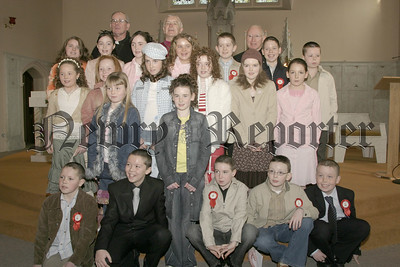 The boys and girls from St Patrick's School Cullyhanna, Pictured at Confirmation in St Patrick's church Cullyhanna last Wednesday, The Celebrant was Bishop G Clifford ,who is pictured  Rev Cullen and Fr P Mc Guckin. 05W9N51.