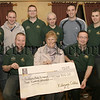 Proceeds from a charity football match between Killowen Celtic and Rostrevor Man-Utd supporters club was presented to Mary Walsh (representing the southern area hospice) from members of Killowen Celtic , The amount was £300.00. 05W9N54.