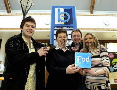 Winner of Apple IPOD Competition, pictured receiving her prize of a 20Gb Apple IPOD is Sharon Robertson from Newry who was the lucky winner of the Buttercrane Outlastnight competition. Karen was one of hundreds who entered the on line competition which was posted on the Buttercrane website. Picture Lto R.Wayne Denner,(Outlastnight.com),Theresa  Clerkin,(Buttercrane centre), Philip Mc Cormack, Karen Robertson,winner.