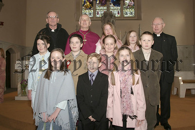 Boys and Girls from St Michael's School Newtownhamilton at Confirmation in St Patrick's Cullyhanna with Bishop G Glifford(centr) Rev Cullen (left) and Fr P Mc Guckin (right).05W9N52.