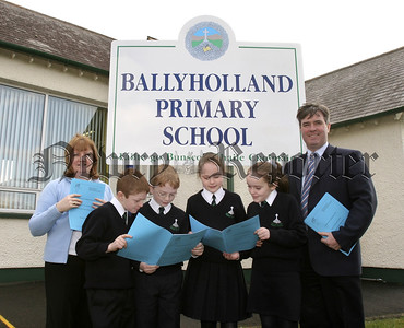 Ballyholland Primary School Principal Mr Colm McAteer, vice-Principal Mrs Ann Curran and pupils, pictured holding the School InspectorÕs Report. 05W8N21.
