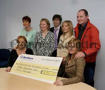 Customs And Excise,(VAT) Newry staff fundraisers have raised money for local charities, Meningitis Research Fund, £3050 proceeds of a Fundraiser at Newry Golf Inn. pictured at the presentation, Paula Strain, (Meningitis Research),Lorainne Mc Manus, Barbara Keenan, Lilian Patterson, Garry Heaney, Tom Brennan, Denise Mc Kay.