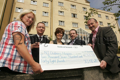 Rory Buchanan President Junior Chamber of Commerce presents Kathleen Smith, Volunteer Ni Childrens Hospice with a cheque for £2748 the proceeds of a Quiz night held in the Canal Court Hotel, Also pictured are, John Slevin, Catherine McGinn and Brendan Malone. 07W24N13