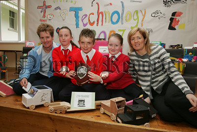 Pictured are pupils Olivia McConaghy, Conor Wallace and Ciara Rocks who have won their regional heats and made it through to the final of the SELB Primary Science and Technology Challenge which will take place in the Odyssey Arena on June 12th, They are seen here being presented with their prizes by Mrs Joan Shine SELB and Teacher Mrs A Slieth. 07W24N1