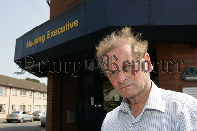 John McArdle pictured outside the Housing Executive which will soon see the re-assignment of 25 employees to Craigavon. 07W24N26