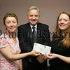 Mr Gary Mills, Trustee of the Lloyds TSB Foundation NI presents a cheque for £5000 to Patricia McNulty, Chairperson CRUSE Breavement Newry and Mourne, Also pictured is Brenda McDowell Management Comittee. 07W25N8