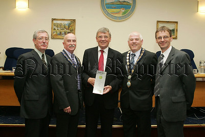 As his final duty as Mayor of Newry and Mourne Michael Car was on hand to accept the Green Apple Award for Built Environment and Architectural Heritage for the New Museum at Bagenals Castle. Also pictured is Thomas McCall, Deputy Mayor Charlie Casey, Mayor Michael Cole and Gerard McGivern. 07W24N34