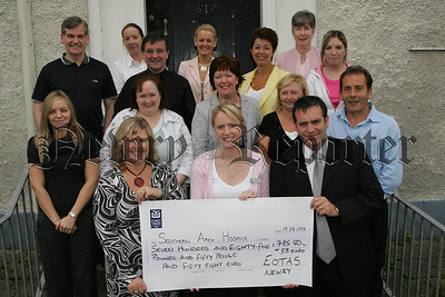 Emma Trainor from Southern Area Hospice accepts a cheque for £785 from Staff at EOTAS Learning Centre, the proceeds of a sponsored walk on Slieve Donard in May. 07W25N29
